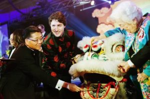 Founder and Chair of Yee Hong Community Wellness Foundation Dr. Joseph Wong, left, Canadian Prime Minister Justin Trudeau and former Mississauga Mayor Hazel McCallion, right, take part in a traditional eye-dotting ceremony before a lion dance at the 27th Annual Dragon Ball Gala, in celebration of the Chinese New Year, in Toronto on Saturday, Feb. 6, 2016. THE CANADIAN PRESS/Michelle Siu